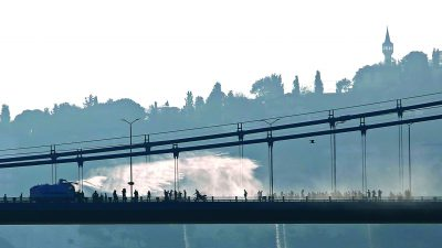 REFILE CORRECTING TYPO - A police armored vehicle uses a water cannon to disperse anti-government forces on Bosphorus Bridge in Istanbul, Turkey, July 16, 2016.  REUTERS/Murad Sezer